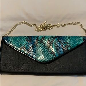 Turquoise and black snake print clutch